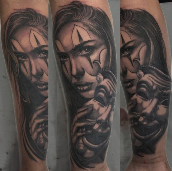 Girl with mask tattoo